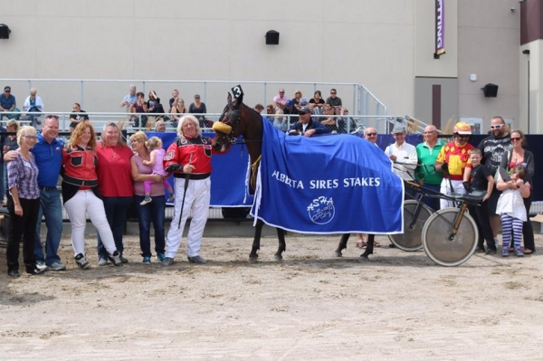 Trainer Harold Haining has a career day in the winner's circle at Century Downs