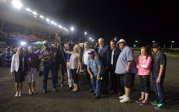 Dr. Maurice Stewart is seen holding on to Wrangler Magic and the Fan Hanover Trophy at Mohawk Racetrack on Saturday, June 20.
