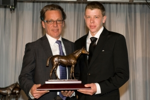 Scott Williams being presented with Sovereign Award for Outstanding Apprentice Jockey of 2012 by Robert King, General Manager of the Jockeys' Benefit Association of Canada