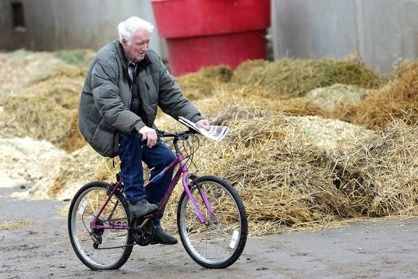 Red McKenzie on his bicycle