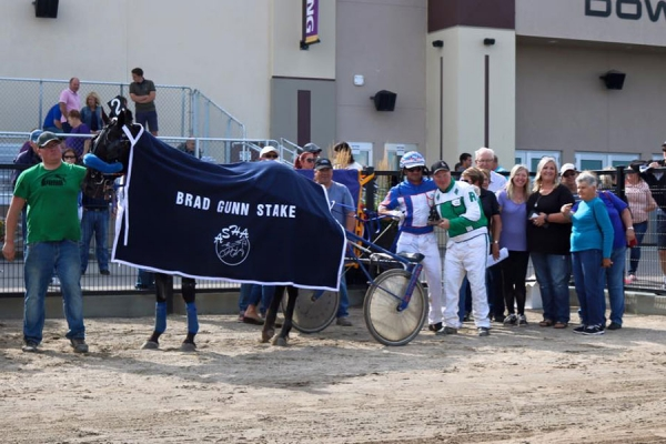 Mike Hennessy and Blue Star Jet in the winner's circle for the Brad Gunn Stake at Century Downs in August 2016