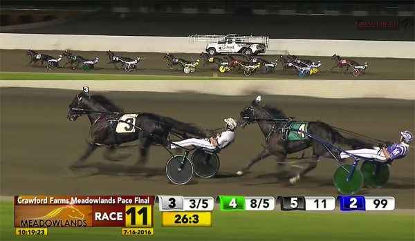 Control The Moment taking the lead in the backstretch of the Meadowlands Pace on July 16, 2016