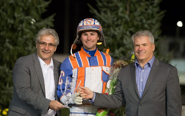 Dan Gall, President & CEO of Standardbred Canada (L) and MIke Woods, Chief Operating Officer of Western Fair District congratulate 2016 National Driving Champion Brandon Campbell of Calgary, AB.