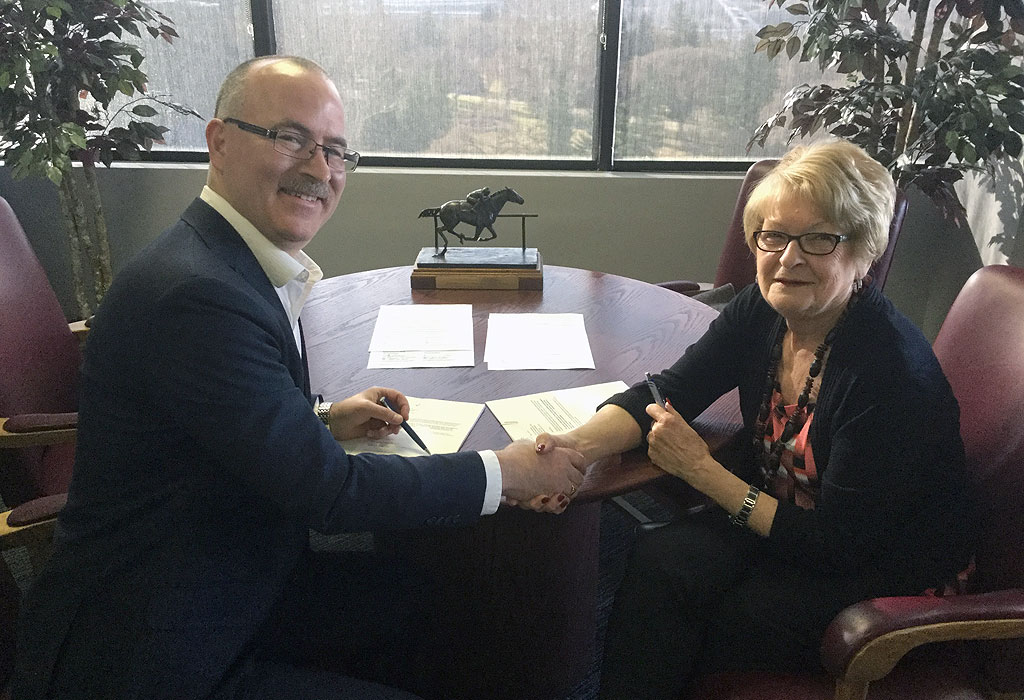 Kevin Gunderman and Shirley McClellan signing 2018 license extension