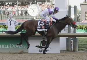 Mario Guitierrez rides Nyquist to victory during the 142nd running of the Kentucky Derby