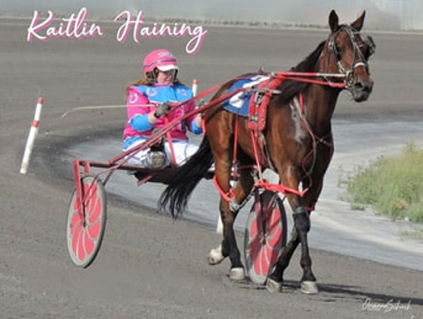 Kaitlin Haining, pictured in the race bike at Century Downs with Bout That Base