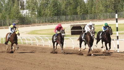 Exactly passing Striders Ring at the wire of Alberta Derby