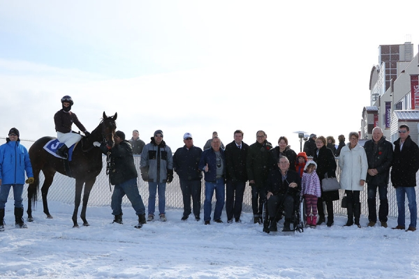 Lynn in the winners' circle at Century Downs in Calgary with Surging Star (Larry Munoz aboard, race 1) on November 4, 2017